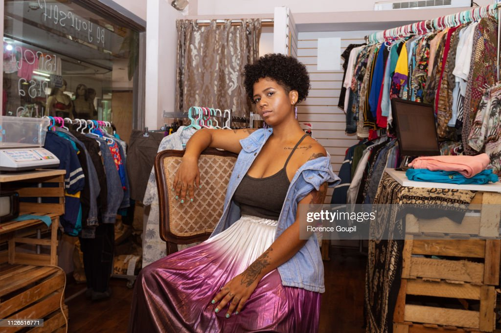 African American woman entrepreneur at her clothing shop : Stock Photo