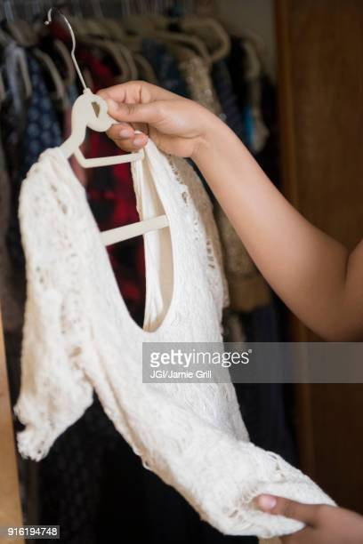 African American woman examining sweater