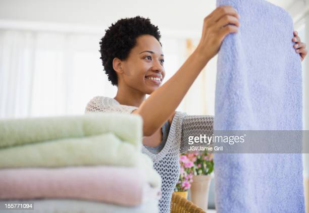 African American woman folding towels