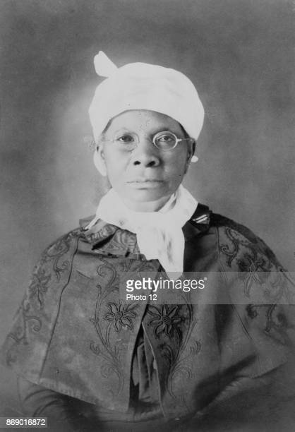 African American woman halflength portrait facing front Photographic print gelatin silver From types of American Negroes compiled and prepared by WEB...