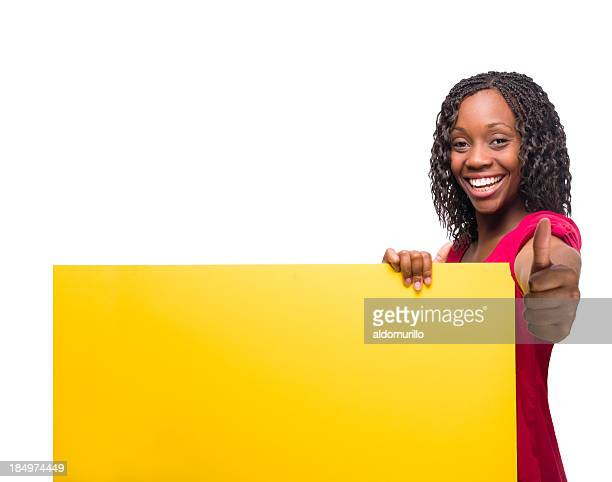 African american woman holding a sign and giving thumbs up