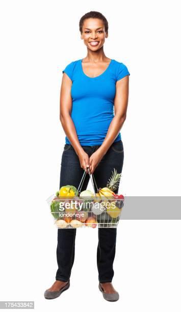 Afrikanische amerikanische Frau hält Korb von Obst und Gemüse-isoliert