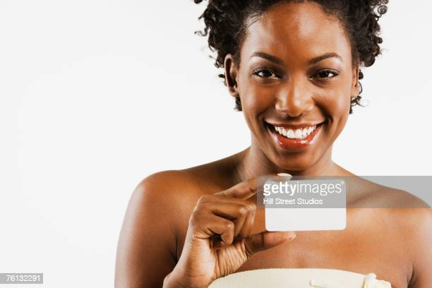 African American woman holding blank card