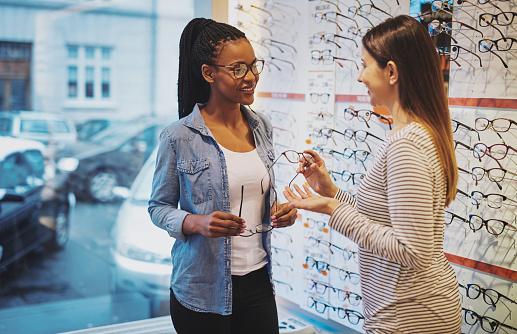 African American woman in an optometrist 578600056