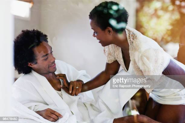 african american woman kneeling on bed with husband - black sexual stock photos and pictures