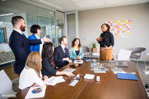 African American Woman Leads Business Team Meeting in the Conference Room