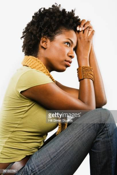 African American woman leaning head on hands