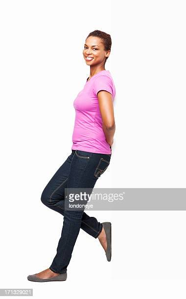 African American Woman Leaning In Casuals - Isolated
