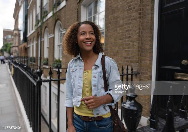 african american woman leaving her house and holding her keys - leaving stock pictures, royalty-free photos & images