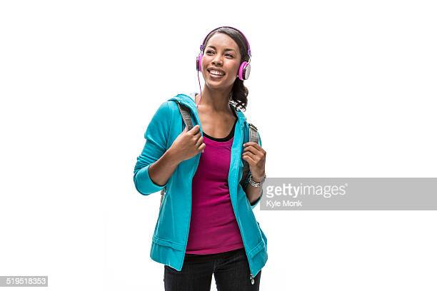 African American woman listening to headphones