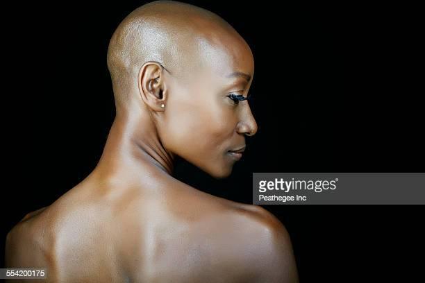 African American woman looking over her shoulder