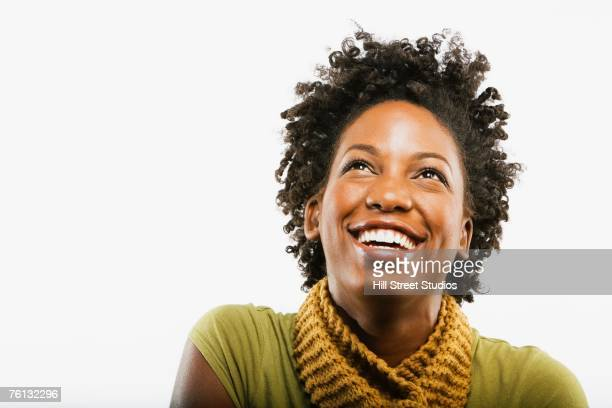 african american woman looking up - 20 29 years stock pictures, royalty-free photos & images
