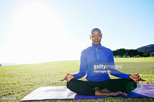 African American woman meditating in park