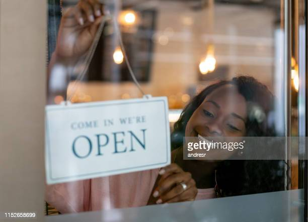 african american woman opening a small business - open for business stock pictures, royalty-free photos & images