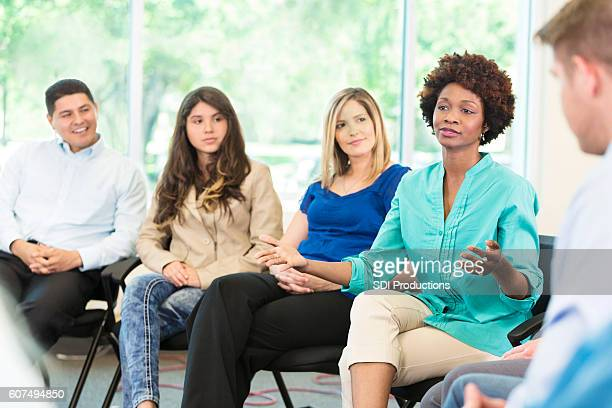 African American woman participates in group therapy