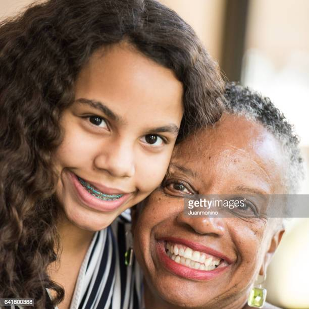African american woman posing with her granddaughter