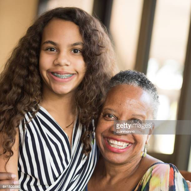 african american woman posing with her granddaughter - 13 year old black girl stock photos and pictures