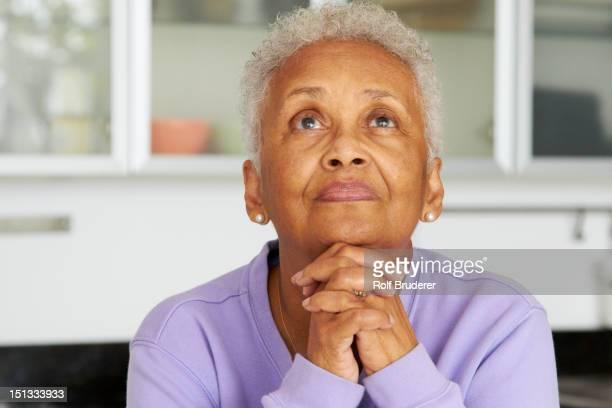 african american woman praying - black people praying stock pictures, royalty-free photos & images