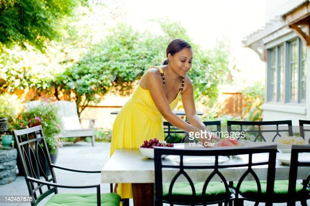 African American woman preparing lunch on patio