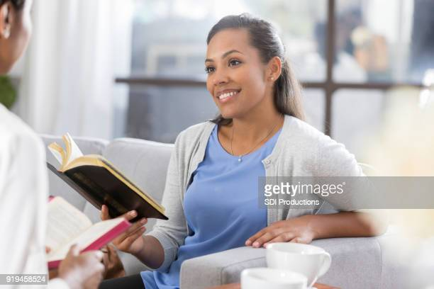 African American woman read the Bible together