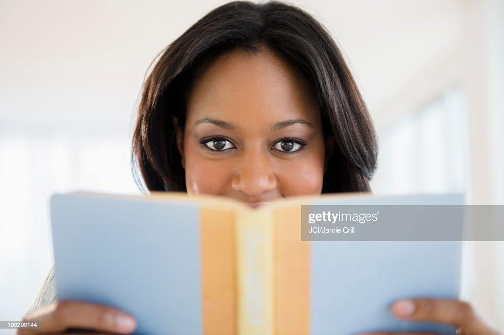 African American woman reading book : Stock Photo