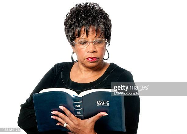 African American Woman Reading the Bible Isolated on White