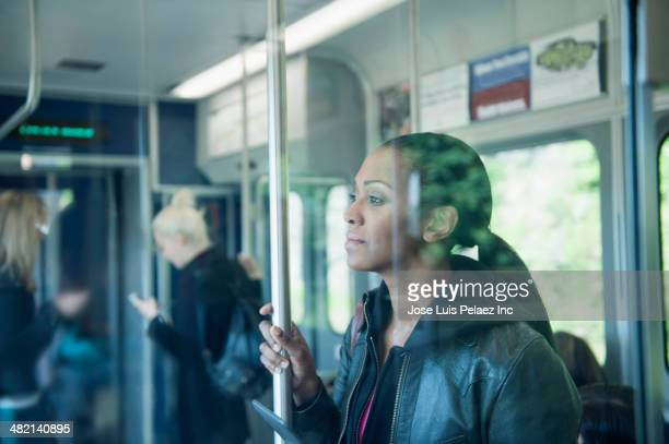 African American woman riding train