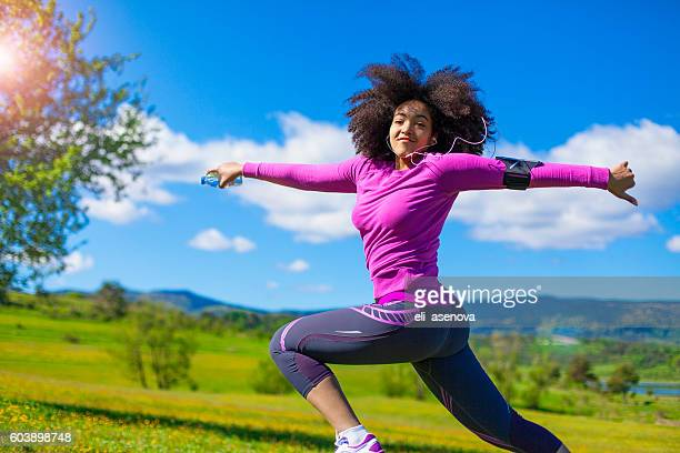 African american woman runner jogging outdoors