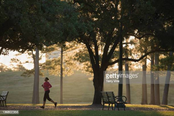 African American woman running in park