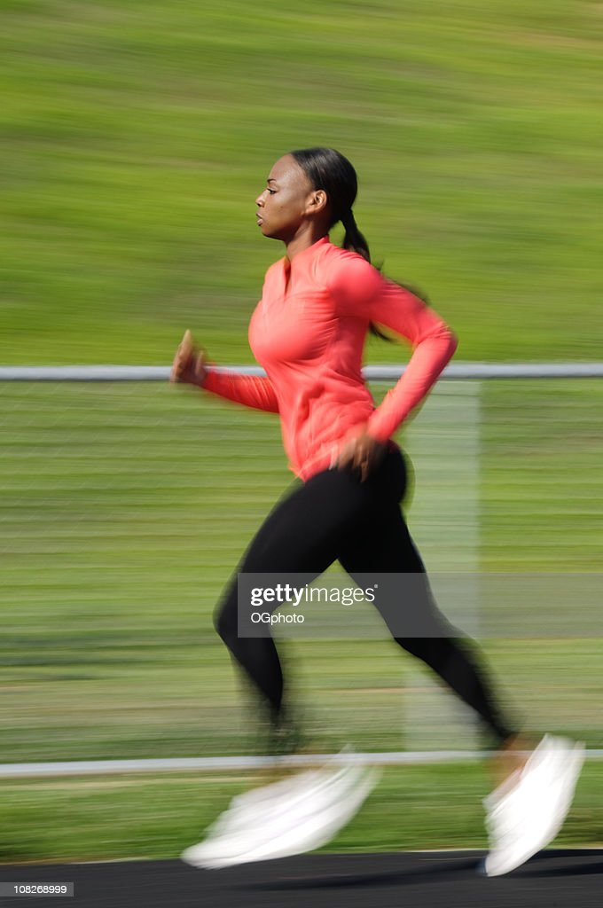African American woman running : Stock Photo