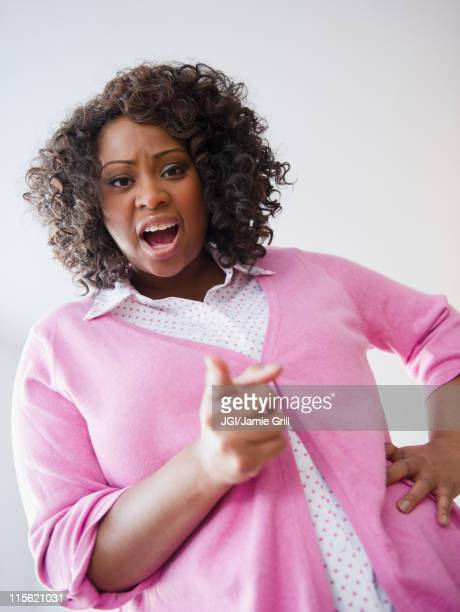 African American woman screaming and pointing her finger
