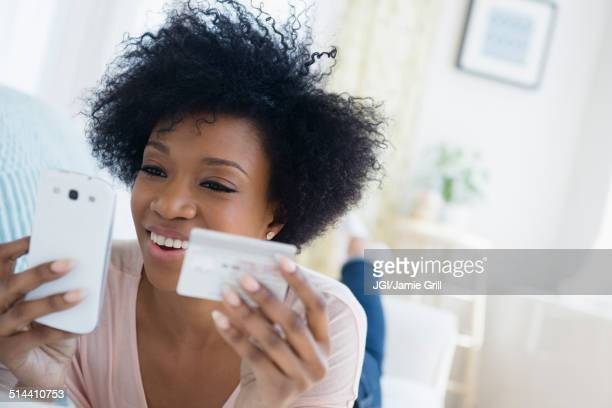 African American woman shopping on cell phone