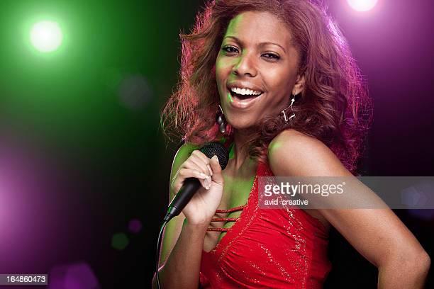African American Woman Singing Karaoke on Stage