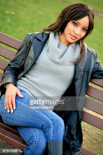 African American Woman Sitting In Park At Winter Stock Photo  Getty Images-1778