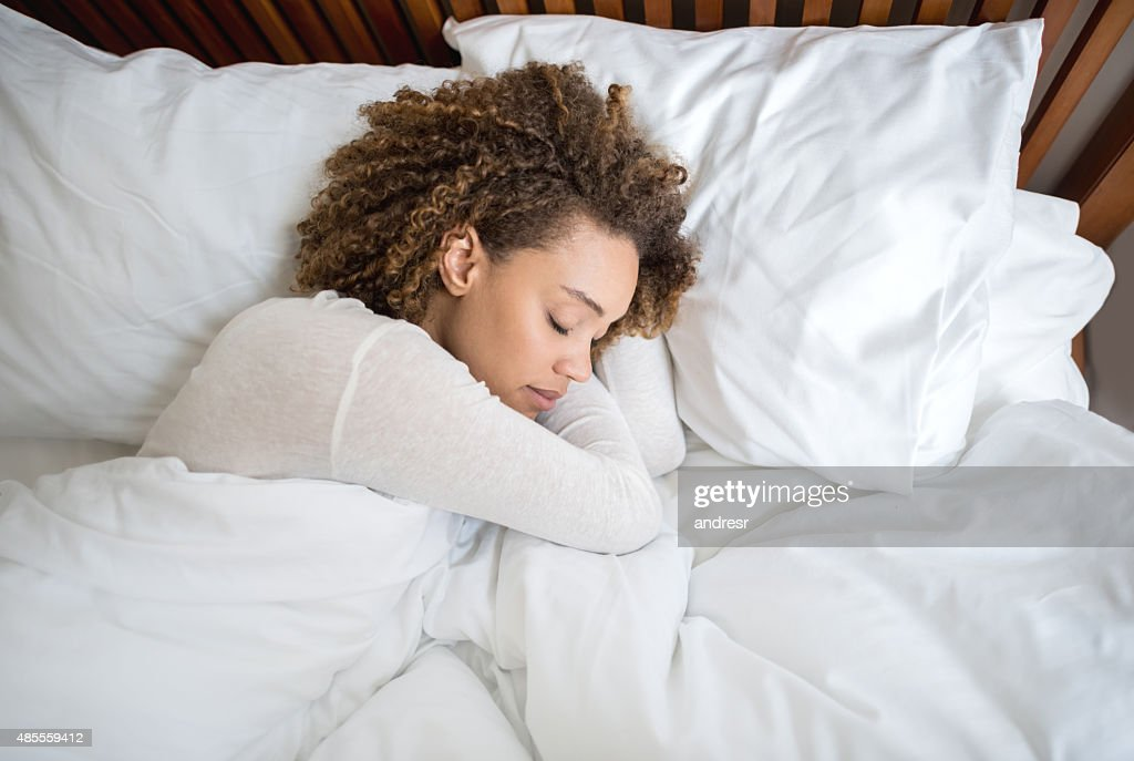 African American woman sleeping in bed : Stock Photo