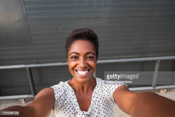 African American woman smiling for selfie