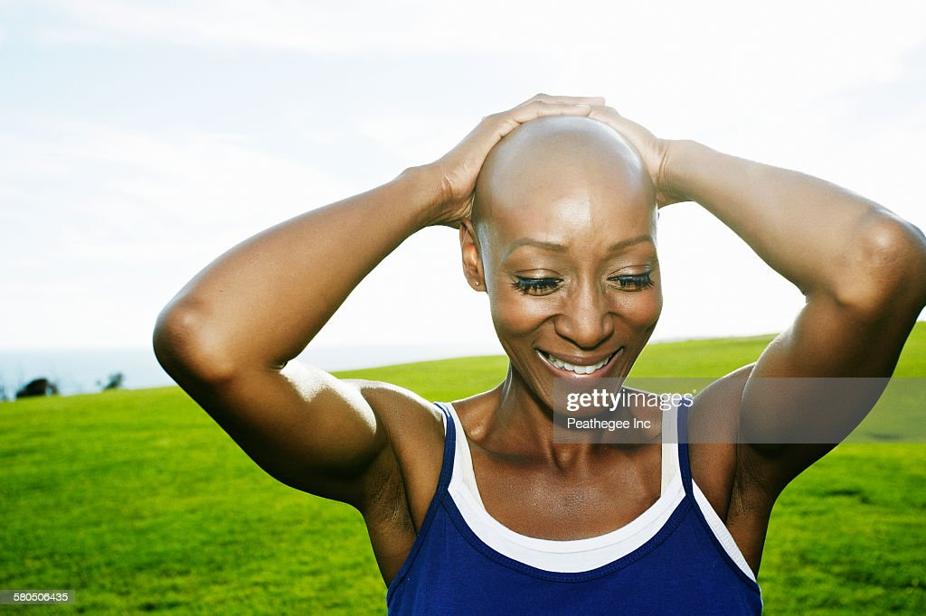 African American woman smiling in park : Stock Photo