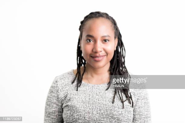 african american woman smiling on white background - non binary gender stock pictures, royalty-free photos & images