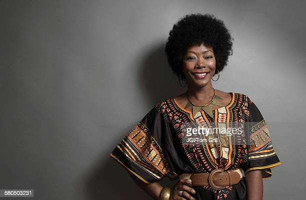 african american woman smiling with hand on hip - traditional clothing stock pictures, royalty-free photos & images