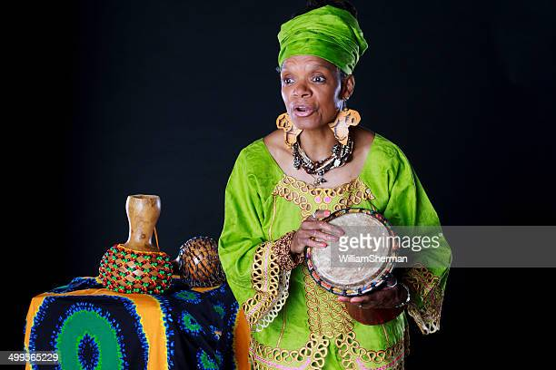 african american woman storyteller in colorful attire - dashiki stock photos and pictures