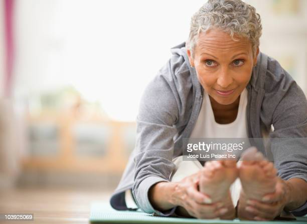 african american woman stretching - active seniors stock pictures, royalty-free photos & images