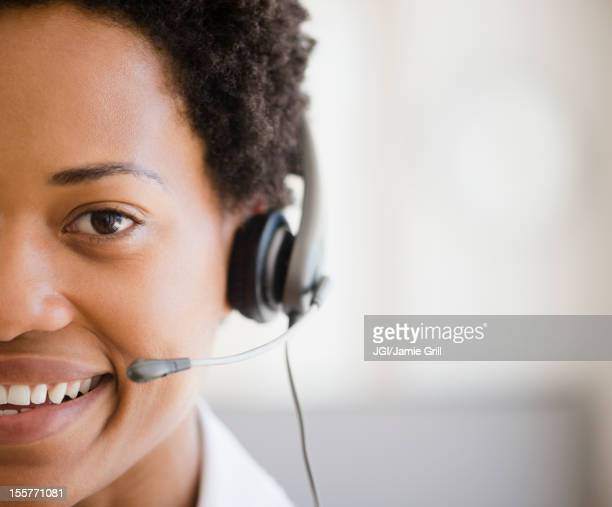 African American woman talking into headset
