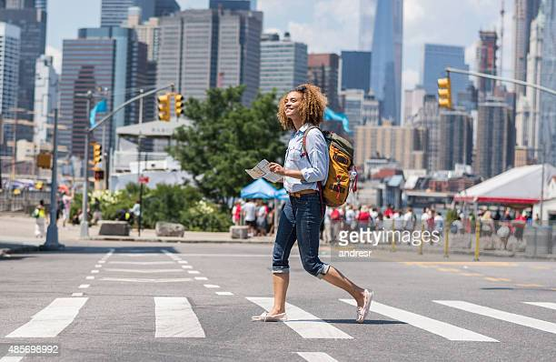 African American woman tourist holding a map in New York