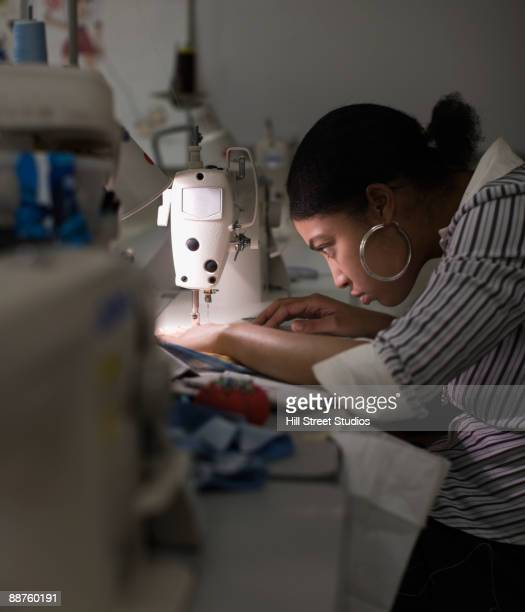 african american woman using sewing machine - sewing stock pictures, royalty-free photos & images