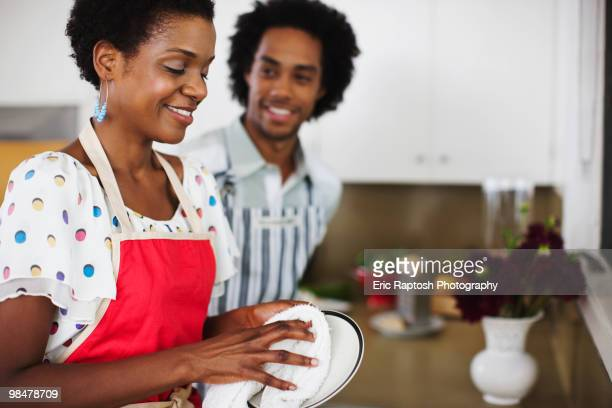 African American woman washing dishes