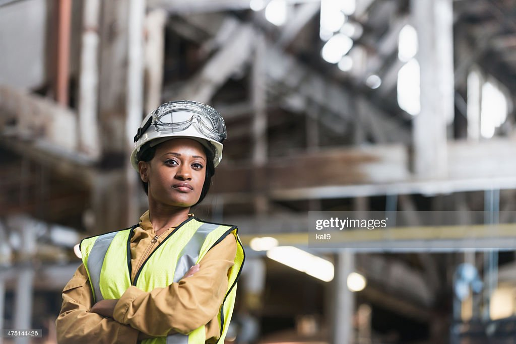 African American woman wearing hardhat and safety vest : Stock Photo