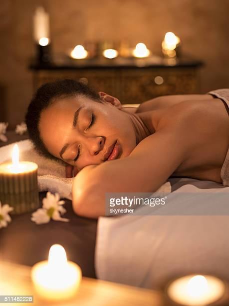 African American woman with eyes closer enjoying at spa.