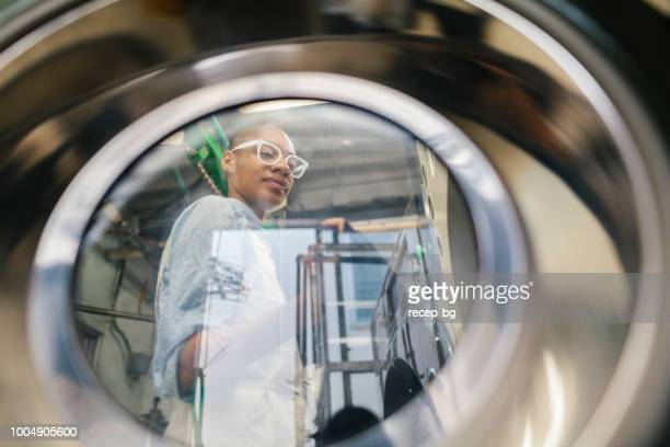 african american woman working in dry cleaning shop - lid stock photos and pictures