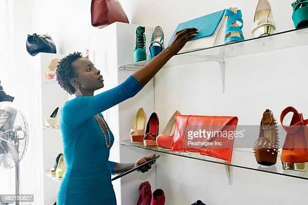 African American woman working in shoe store