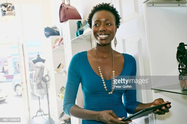 african american woman working in shoe store - convenient store stock photos and pictures
